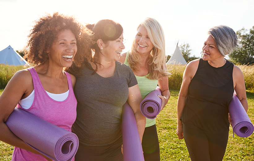 Group of women enjoying the outdoors after a yoga session.